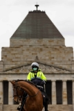MELBOURNE, VIC - SEPTEMBER 12: A mounted Police Officer stands ready at The Shrine during the Melbourne Freedom Walk Rally on September 12, 2020 in Melbourne, Australia. Stage 4 restrictions are in place from 6pm on Sunday 2 August for metropolitan Melbourne. This includes a curfew from 8pm to 5am every evening. During this time people are only allowed to leave their house for work, and essential health, care or safety reasons. Despite this, multiple protests are being arranged to push back against the draconian restrictions in place within metropolitan Melbourne. A Freedom Walk was arranged to take place in the Tan but with hundreds of police and wet weather forecast, only a small number of protesters tried to attend before being ordered to move on. (Photo by Speed Media/Icon Sportswire)